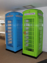 A blus Phoney Box and a green Phoney Box installed in an office